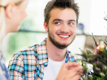 Portrait of smiling office worker with little Christmas tree Stock Image