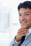 Portrait of a smiling office worker thinking Royalty Free Stock Images