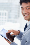 Portrait of a smiling office worker using a tablet computer Royalty Free Stock Photos