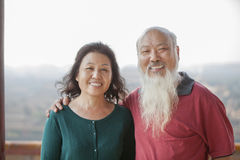 Portrait Of Smiling Old Couple In Jing Shan Park Royalty Free Stock Photo