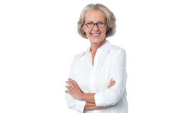 Portrait of smiling old lady, arms crossed Stock Photography