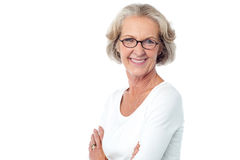 Portrait of smiling old lady, arms crossed. Royalty Free Stock Photography