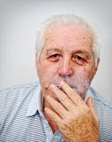 A portrait of a smiling old man Stock Images