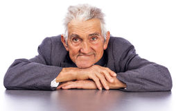 Portrait of a smiling old man looking at camera. Against white background Royalty Free Stock Photography