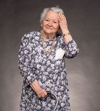 Portrait of smiling old woman Royalty Free Stock Image