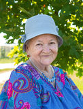 Portrait of smiling old woman in hat Stock Photo