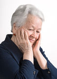 Portrait of smiling old woman Stock Image