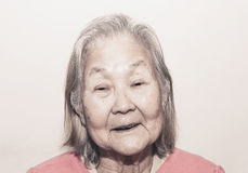 Portrait of a smiling old woman with white hair Stock Image