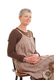Portrait of smiling older woman sitting sideways Stock Images