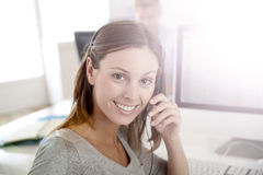 Portrait of smiling operator with headset working Royalty Free Stock Image