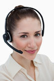 Portrait of a smiling operator posing with a headset Royalty Free Stock Photo
