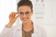 Portrait of smiling ophthalmologist doctor woman Stock Photography