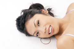 Portrait smiling Pacific Islander Woman reclining Royalty Free Stock Image