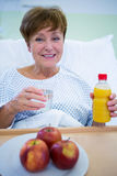 Portrait of smiling patient having a breakfast Royalty Free Stock Images