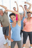 Portrait of smiling people doing power fitness exercise Royalty Free Stock Photos
