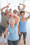 Portrait of smiling people doing power fitness exercise Royalty Free Stock Images