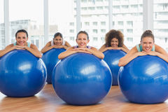 Portrait of smiling people with exercise balls Royalty Free Stock Photo