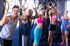 Portrait of smiling people with gymnastic rings Royalty Free Stock Photography