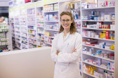 Portrait of a smiling pharmacist  in lab coat with arms crossed Stock Photography