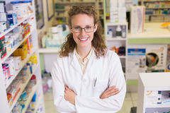 Portrait of a smiling pharmacist in lab coat looking at camera Stock Images