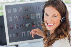 Portrait of a smiling photo editor wearing a headset Royalty Free Stock Photography