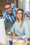 Portrait of smiling photo editors in office Royalty Free Stock Image