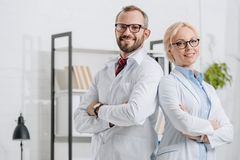 portrait of smiling physiotherapists in white coats looking at camera