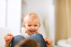 Portrait of smiling playing baby Stock Images