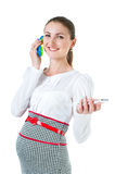 Portrait of smiling pregnant businesswoman talking toy phone and Stock Image
