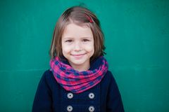 Portrait of smiling preschooler girl. Young toddler girl outdoor. This image has attached release Stock Photography
