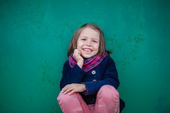 Portrait of smiling preschooler girl. Young toddler girl outdoor. This image has attached release Royalty Free Stock Photo