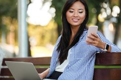 Portrait of a smiling pretty asian female student stock photos