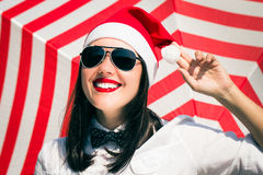 Portrait of a smiling pretty girl in Santa Claus hat Stock Photography