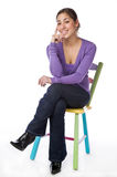 Portrait of a smiling pretty woman sitting Stock Photography