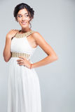 Portrait of a smiling pretty woman in white dress Royalty Free Stock Photos