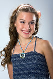 Portrait of a smiling pretty young girl. With long ringlets hair Royalty Free Stock Images