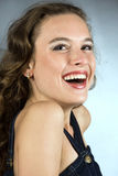 Portrait of a smiling pretty young girl. With clean skin. Girl with long curly hairs Stock Photography