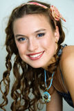 Portrait of a smiling pretty young girl. With clean skin. Girl with long curly hairs Stock Photos