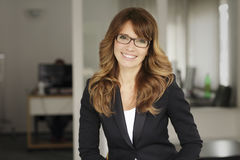 Portrait of a smiling professional mature businesswoman Royalty Free Stock Photo