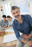 Portrait of smiling professor in class Royalty Free Stock Photo