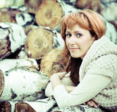 Portrait of a smiling red haired woman in autumn day Royalty Free Stock Photos