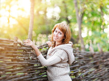 Portrait of a smiling red haired woman outdoors Royalty Free Stock Photos