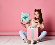 Girl sitting floor birthday gifts royalty free stock photo