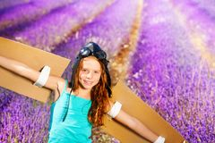 Cute girl in pilot costume against lavender field stock photography