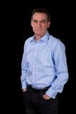 Portrait of Smiling Relaxed Business Man in Blue Shirt Royalty Free Stock Photo