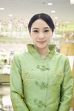 Portrait of Smiling Restaurant/Hotel Hostess in Traditional Chinese Clothing in the Restaurant Stock Images