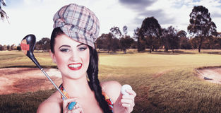 Portrait of a smiling retro female golfer Royalty Free Stock Photos
