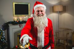 Portrait of smiling Santa Claus gesturing. At home Royalty Free Stock Photography