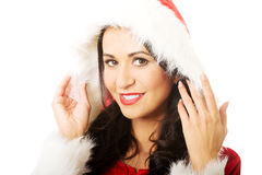 Portrait of smiling santa woman touching her hat Stock Photo