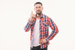 Portrait of a smiling satisfied man in plaid shirt pointing at camera isolated on a white background Stock Photo